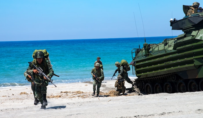 U.S. Marines and Philippine Marines conduct an amphibious landing during KAMANDAG 2 in Naval Education Training Command, Philippines, Oct. 6, 2018. KAMANDAG helps maintain a high level of readiness and enhances bilateral military-to-military relations and capabilities.