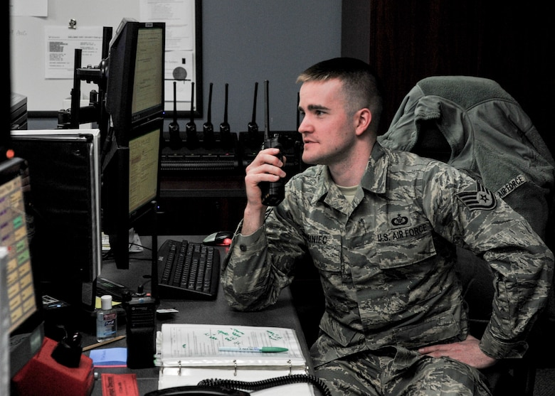 Staff Sgt. Michael Duniec, an operations controller with the 910th Airlift Wing Command Post, coordinates a C-130H Hercules permission to park in a requested space on Youngstown Air Reserve Station's flightline April 9, 2018. Duniec joined the Air Force Reserve at 17 with a parental wavier, he was inspired by his father's four years active duty service in the Air Force working on the Titan II Two Missile Silos in peacetime.