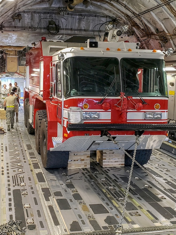 A P-23 Airport Rescue Fire Fighting Truck is shored and secured in a C-17 Globemaster III Sept. 26, 2018, at Joint Base Charleston, S.C. The P-23 weighed 44,600 pounds and was airlifted to North Auxiliary Airfield in North, S.C., to maintain emergency response readiness of the airfield after Hurricane Florence.