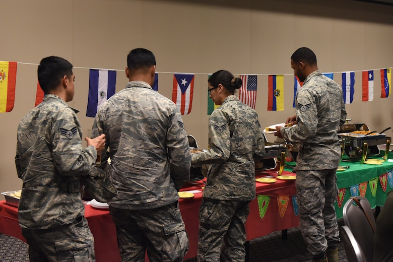 Airmen get authentic Hispanic food during the Hispanic Heritage Fiesta at the the Event Center on Goodfellow Air Force Base, Texas, Oct. 5, 2018. A few of the dishes provided were pernil (roasted pork shoulder), arroz con gandules (rice with pigeon peas) and virgin coquito (cinnamon-spiced coconut milk egg nog). (U.S. Air Force photo by Airman 1st Class Zachary Chapman/Released)