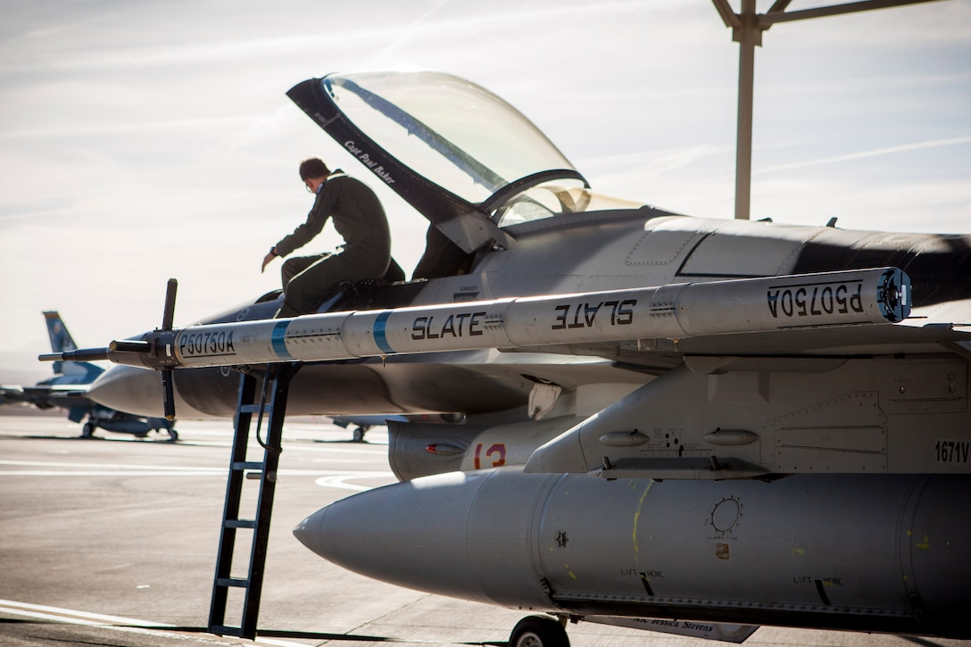 The Secure Live Virtual Constructive Advanced Training Environment (SLATE) LVC pod is attached to an F-16 with the 64th Aggressor Squadron during an Electromagnetic Interference/Compatibility test at Nellis AFB, Nevada, during Phase I of the demonstration in June. (U.S. Air Force photo/William Graver)