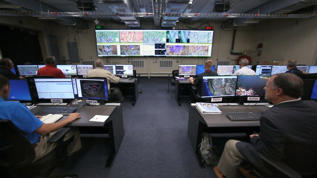 Part of the Secure Live Virtual Constructive Advanced Training Environment (SLATE) team sit in the operation center at Nellis Air Force Base, Nevada, during the Phase III capstone demonstration in September.(U.S. Air Force photo/William Graver)