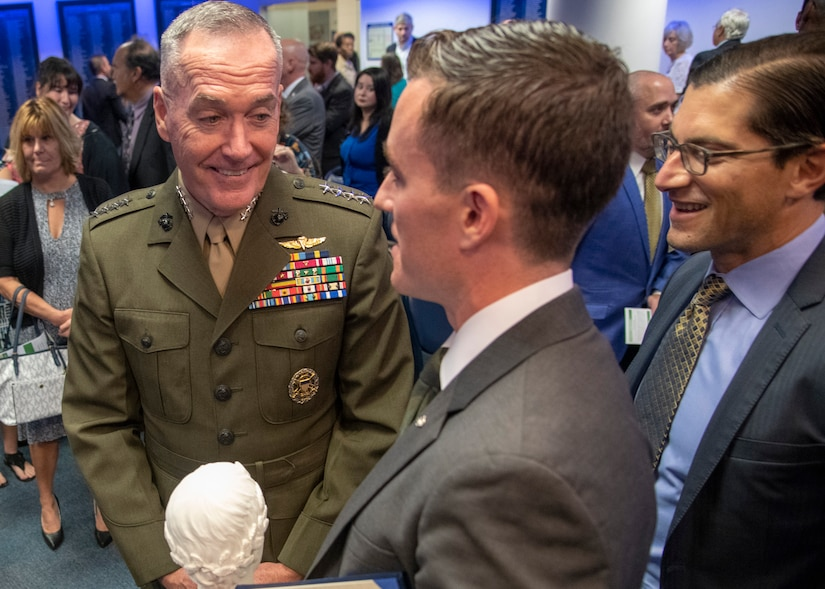 Marine Corps Gen. Joe Dunford, chairman of the Joint Chiefs of Staff, speaks to James Ferguson, founder of the Warrior Reunion Foundation of Cockeysville, Maryland, during the 2018 Newman's Own Awards at the Hall of Heroes in the Pentagon, Oct. 5, 2018. The annual competition seeks to reward ingenuity for programs that benefit service men, women, and their families. DoD photo by Navy Petty Officer 1st Class Dominique A. Pineiro
