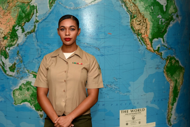 U.S. Marine Corps Lance Cpl. Destiny Creecy, Marine Corps Detachment at Goodfellow student, stands in front of a map at Brandenburg Hall on Goodfellow Air Force Base, Texas, Oct. 5, 2018. Creecy is the Goodfellow Student of the Month spotlight for September 2018, a series highlighting Goodfellow students. (U.S. Air Force photo by 2nd Lt. Matthew Stott/Released)