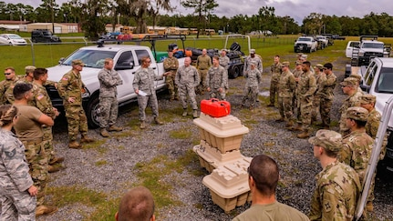 Members of the Florida National Guard Chemical, Biological, Radiological, Nuclear, High Yield Explosive Enhanced Response Force Package (CERF-P) prepare for missions in response to Hurricane Michael at Camp Blanding Joint Training Center near Starke, Florida on Oct. 9, 2018.