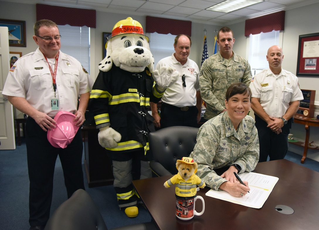 U.S. Air Force Col. Debra Lovette, 81st Training Wing commander, signs the Fire Prevention Week Declaration at the 81st TRW headquarters building on Keesler Air Force Base, Mississippi, Oct. 9, 2018. The week-long event includes fire drills, literature hand-outs and stove fire demonstrations around the base and concludes with an open house at the fire department on Oct. 13. (U.S. Air Force photo by Kemberly Groue)