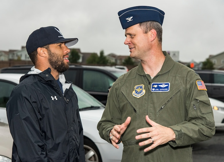 Col. Joel Safranek, 436th Airlift Wing commander, speaks with Bubba Wallace, driver of the No. 43 World Wide Technology Chevrolet in the Monster Energy NASCAR Cup Series, prior to arriving at the NASCAR Social Oct. 5, 2018, at The Landings on Dover Air Force Base, Del. Wallace provided autographed information cards to attendees. (U.S. Air Force photo by Roland Balik)