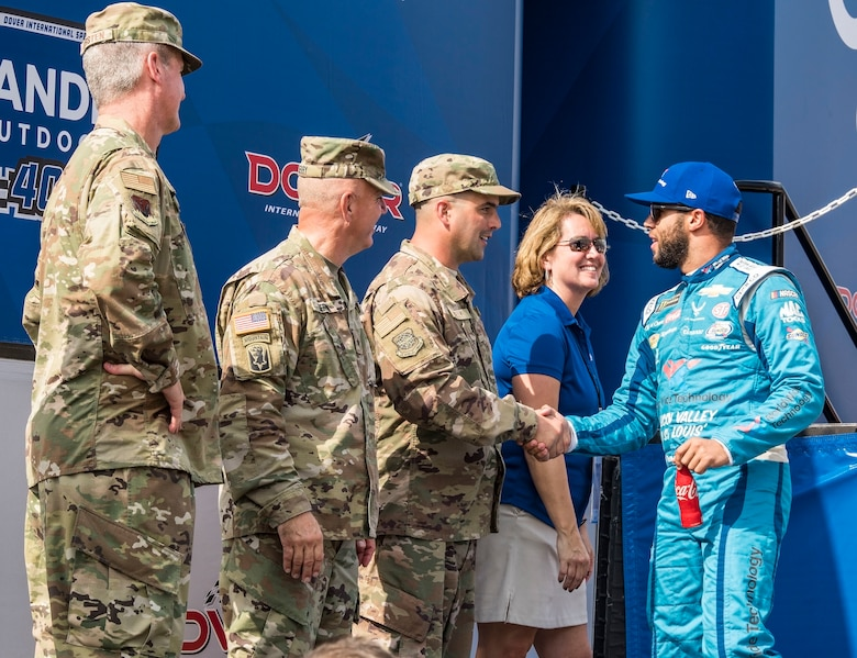 "Bubba Wallace, driver of the No. 43 World Wide Technology Chevrolet in the Monster Energy NASCAR Cup Series, shakes hands with Tech. Sgt. Michael Kelly, 736th Aircraft Maintenance Squadron C-17 Globemaster III flight line expediter, during driver introductions Oct. 7, 2018, at Dover International Speedway in Dover, Del. Kelly was selected as the honorary starter for the ""Gander Outdoors 400"" Monster Energy NASCAR Cup Series race. (U.S. Air Force photo by Roland Balik)"