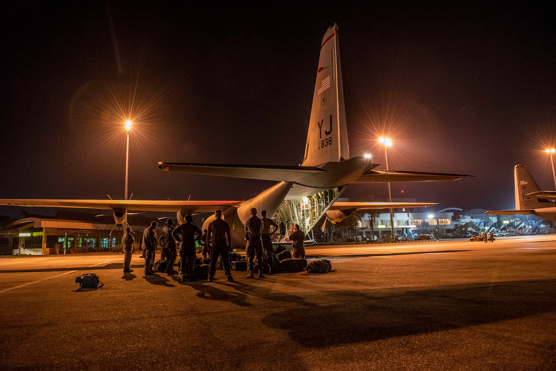 U.S. Air Force members assigned to the 36th Contingency Response Group Andersen Air Force Base, Guam, three C-130J Super Hercules aircraft and aircrew from the 374th Airlift Wing, Yokota Air Base, Japan arrive at Balikpapan, Indonesia Oct. 5, 2018. Members are supporting USAID's humanitarian relief efforts after a 7.5 magnitude earthquake and tsunami struck Indonesia's Sulawesi Island Sept. 28, 2018. (U.S. Air Force photo by Master Sgt. JT May III)
