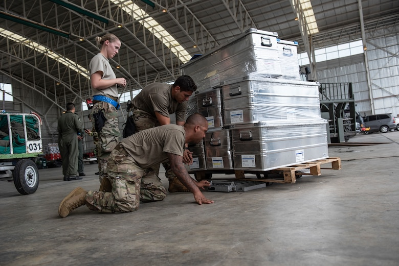 U.S. Air Force aerial porters assigned to the 36th Contingency Response Group Andersen Air Force Base, Guam, prepare and inspect cargo at the airport in Balikpapan, Indonesia Oct. 5, 2018. The airport is the staging ground for all humanitarian goods before being transported to Palu, Indonesia where they are received and distributed to those affected by the 7.5 magnitude earthquake and tsunami. (U.S. Air Force photo by Master Sgt. JT May III)