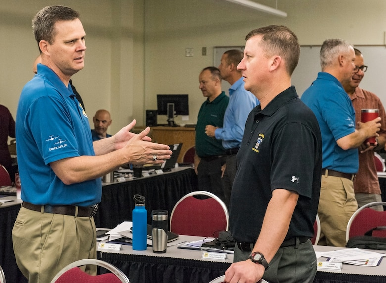 Col. Joel Safranek (left), 436th Airlift Wing commander, speaks with Col. Matthew Jones, 436th AW vice commander, prior to a 436th AW leadership offsite meeting Sept. 13, 2018, at Delaware Technical Community College in Dover, Del. During his opening remarks, Safranek expressed what his expectations were for the two-day offsite. (U.S. Air Force photo by Roland Balik)