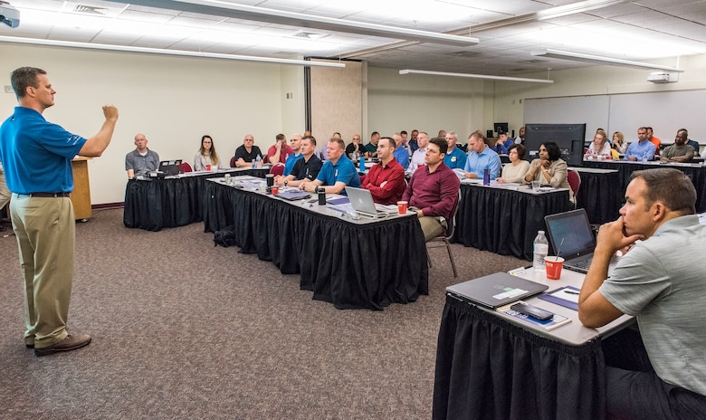 Col. Joel Safranek (left), 436th Airlift Wing commander, speaks to group and squadron commanders and superintendents at the start of a 436th AW leadership offsite meeting Sept. 13, 2018, at Delaware Technical Community College in Dover, Del. The two-day offsite brought leadership together to discuss numerous topics such as the mission, vision and priorities of the 436th AW. (U.S. Air Force photo by Roland Balik)