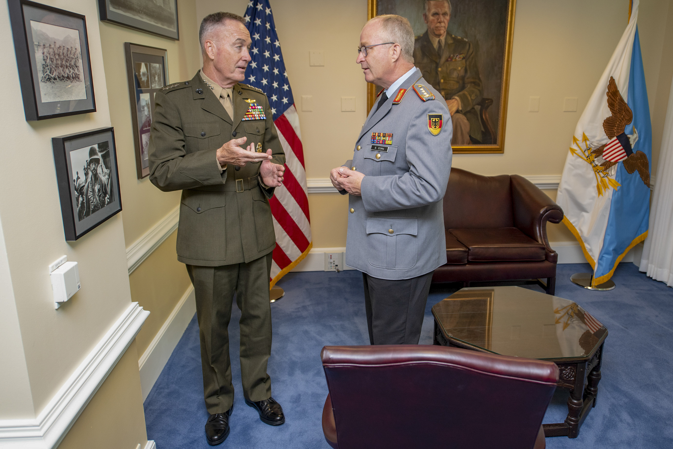 Marine Corps Gen. Joe Dunford, chairman of the Joint Chiefs of Staff, gives German Inspector Gen. Eberhard Zorn, chief of staff of the Federal Armed Forces, a tour of his office at the Pentagon.