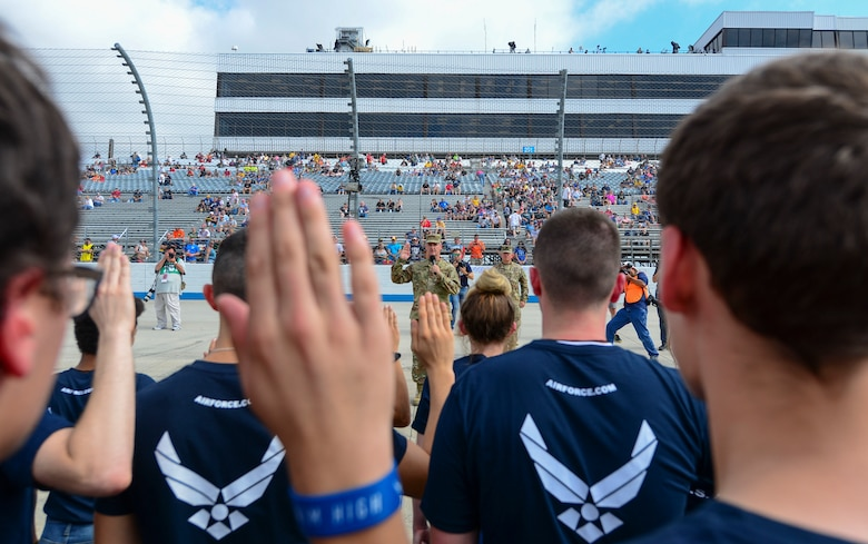 Delayed Entry Program enlistees repeat the oath of enlistment Oct. 7, 2018, administered by Maj. Gen. Peter Gersten, U.S. Air Force Warfare Center commander, Nellis Air Force Base, Nev., at the Dover International Speedway in Dover, Del. Soon, these enlistees will be sent to their respective basic military training installations. (U.S. Air Force photo by Airman First Class Dedan D. Dials)