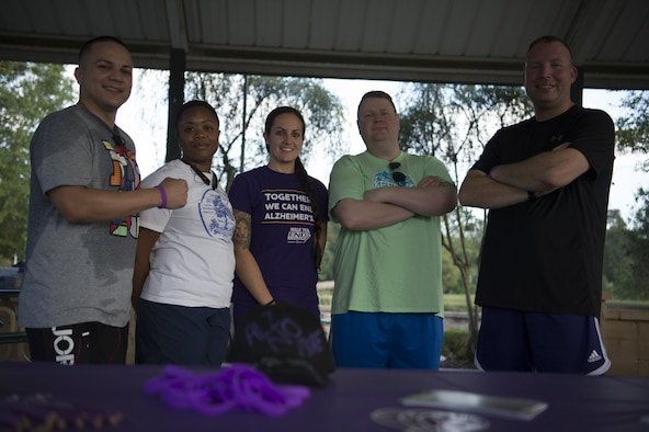 Team Shaw members pose after jogging laps around Memorial Lake at the Alzheimer's walk at on Shaw Air Force Base, S.C., Oct. 4, 2018.