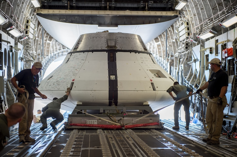 The NASA Orion test capsule is loaded into a C-17 Globemaster III on loan from Joint Base Lewis-McChord, Washington, Sept. 10, 2018. The mock capsule was later pulled out the back of the cargo plane Sept. 12 for its final parachute system test over the U.S. Army's Yuma Proving Ground in Arizona. (U.S. Air Force photo by Kyle Larson)