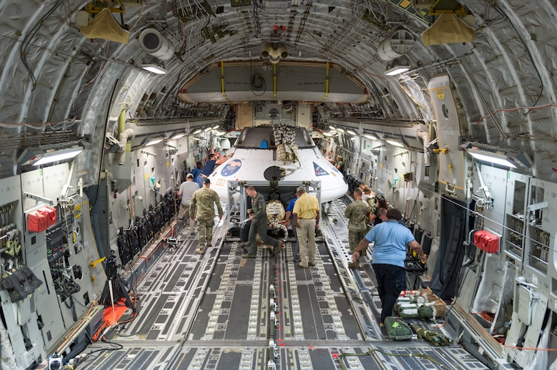 A team of NASA, U.S. Army and 418th Flight Test Squadron personnel secure the NASA Orion test capsule in the cargo area of C-17 Globemaster III Sept. 10, 2018. The mock capsule was later pulled out the back of the cargo plane Sept. 12 for its final parachute system test over the U.S. Army's Yuma Proving Ground in Arizona. (U.S. Air Force photo by Kyle Larson)