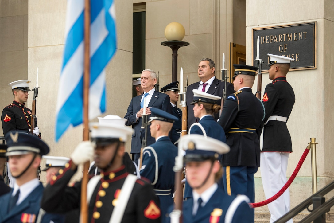 Defense Secretary James N. Mattis and his Greek counterpart stand on the Pentagon steps, flanked by service members.