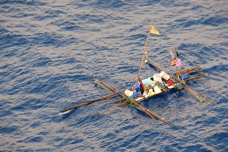 SOUTH CHINA SEA—A makeshift boat filled with minimal supplies sits distressed and adrift in the South China Sea, Oct. 8. Five Filipino fishermen survived for five days aboard a makeshift boat after their fishing boat sank at sea and they were rescued by the crew of USNS Wally Schirra (T-AKE 8).