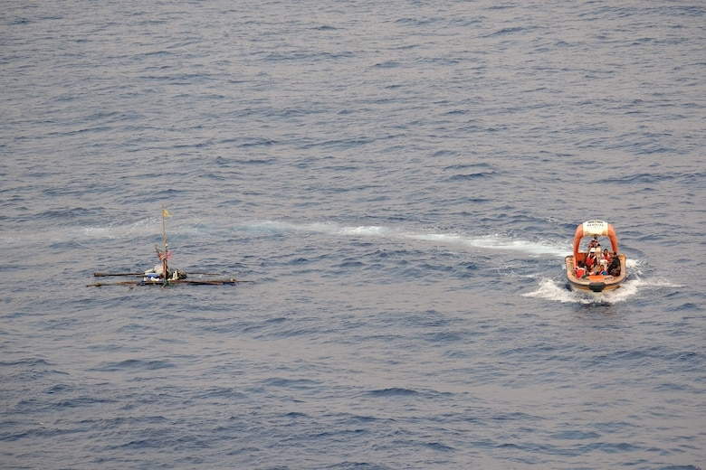 SOUTH CHINA SEA—A rigid-hulled, inflatable boat deployed off the USNS Wally Schirra (T-AKE 8) circles a distressed and adrift boat in the South China Sea, Oct. 8. Five Filipino fishermen survived for five days aboard a makeshift boat after their fishing boat sank at sea and they were rescued by the crew of USNS Wally Schirra.
