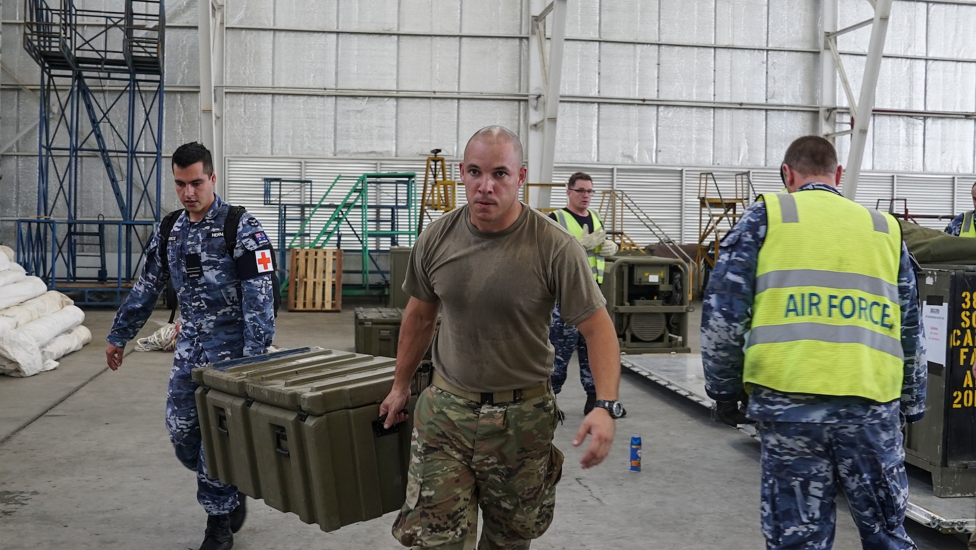 U.S. Air Force Tech Sgt. Eliezer Ribeiro, 36th Contingency Response Group vehicle maintenance NCO in charge at Andersen Air Force Base, helps Royal Australian Air Force medical personnel offload supplies in Balikpapan, Indonesia. The Indonesian Government and U.S. Agency for International Development are working alongside eight countries agencies and foreign militaries ensuring supplies, airlift, shelter and medical support reach those affected. (U.S. Air Force photo by Master Sgt. JT May III)