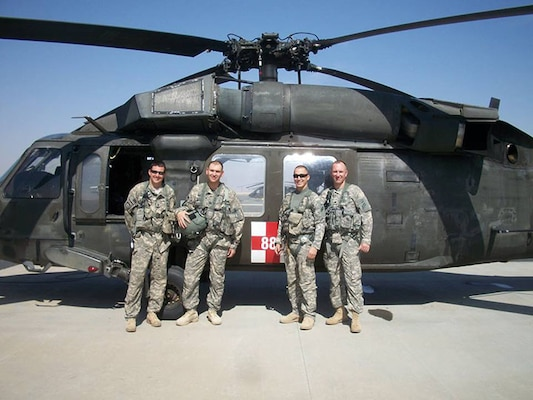 New York Army National Guard Maj. Stephen Carson, second from left, is seen with his aeromedical flight crew at Udairi Airfield after a mission during his deployment to Kuwait in 2013-14. Carson, then a captain, served as a Physician's Assistant in support of the New York Army National Guard's 642nd Support Battalion, part of the 42nd Combat Aviation Brigade.