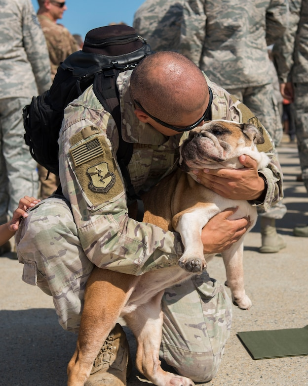 U.S. Air Force Master Sgt. David Gonzalez, 1st Maintenance Squadron production superintendent, hugs his dog, Roxy, at Joint Base Langley-Eustis, Virginia, Oct. 9, 2018.