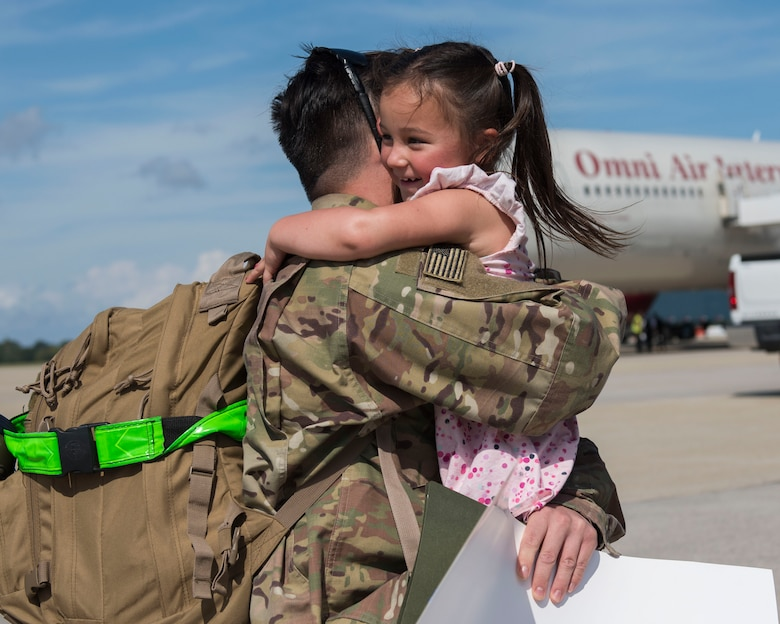U.S. Air Force Senior Airman Matthew Adams, 1st Maintenance Squadron low observable technician, hugs his daughter, Lilly, 4, at Joint Base Langley-Eustis, Virginia, Oct. 9, 2018.