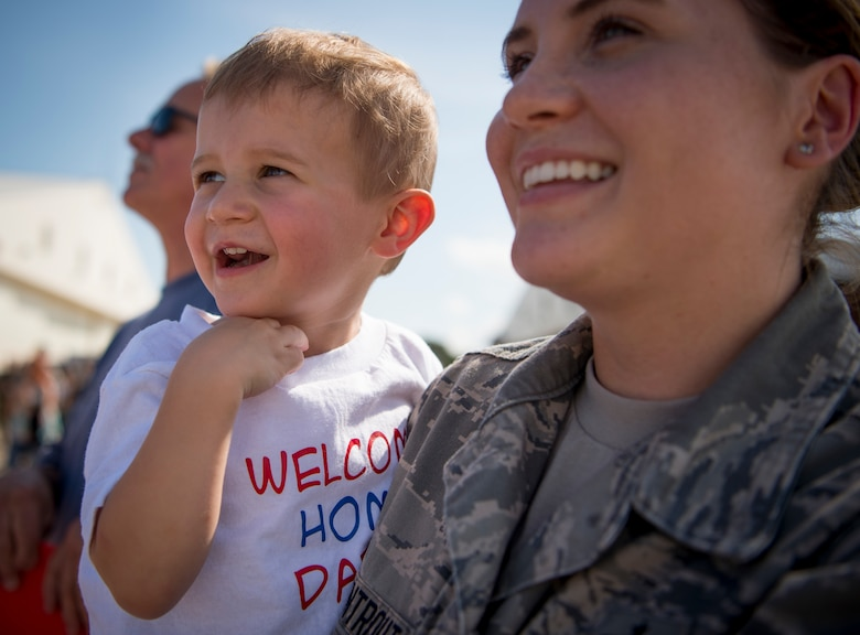 Right, U.S. Air Force Staff Sgt. Britney Armentrout, 1st Operations Support Squadron airfield management training NCO in charge, and her son, Greyson Ramsey, wait to greet their family member as they return from deployment at Joint Base Langley-Eustis, Virginia, Oct. 1, 2018