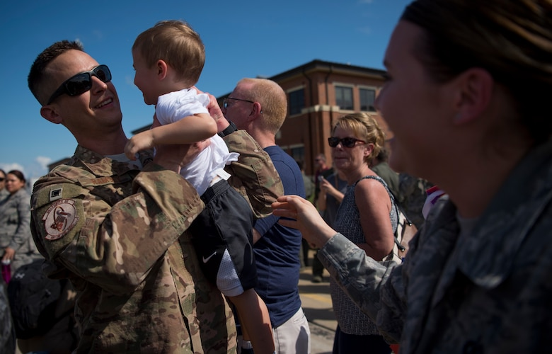 U.S. Air Force Staff Sgt. Matthew Ramsey, 1st Operations Support Squadron aircrew flight equipment technician, is greeted by his son Greyson as he returns from deployment at Joint Base Langley-Eustis, Virginia, Oct. 9, 2018.