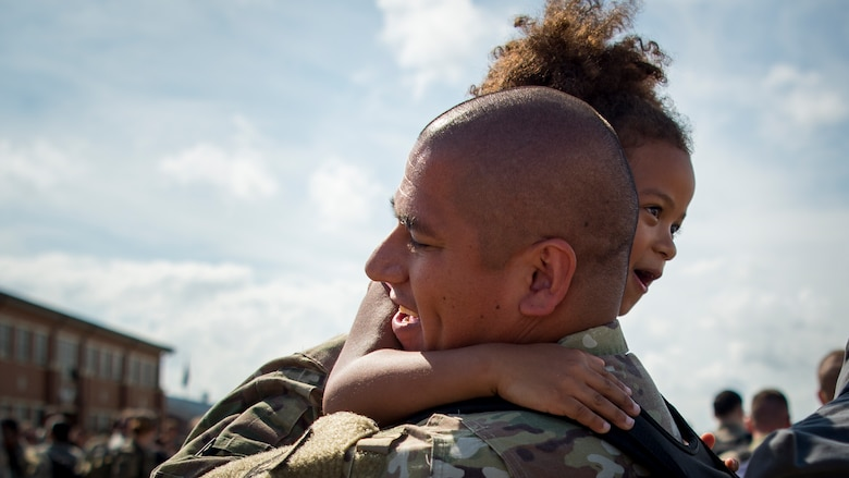 U.S. Air Force Master Sgt. Victor Chavez, 1st Maintenance Squadron fabrication flight chief, embraces his daughter upon return to Joint Base Langley-Eustis, Virginia, Oct. 9, 2018.