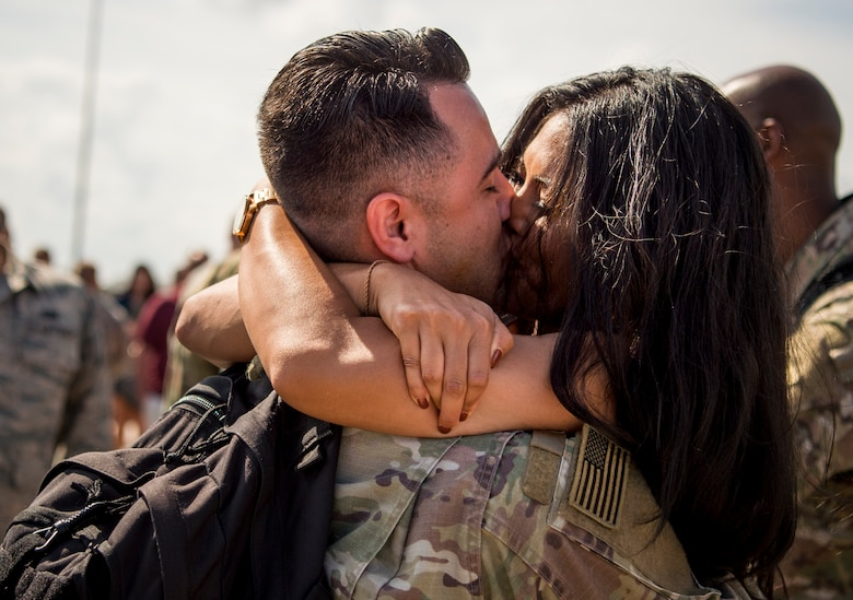 U.S. Air Force Airman 1st Class Cecil Chaney, 1st Maintenance Squadron nondestructive inspection technician, is greeted by Lena Tes as he returns from deployment at Joint Base Langley-Eustis, Virginia, Oct. 9, 2018.