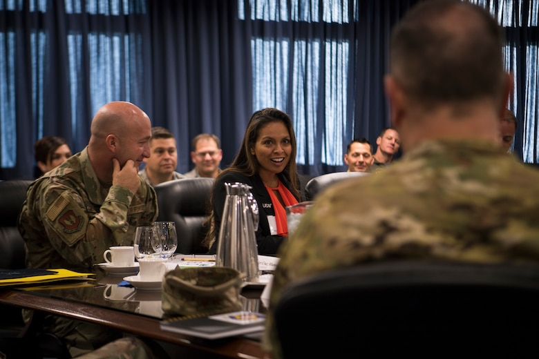 Lora Cruz Munoz, spouse of Third Air Force Command Chief Master Sgt. Anthony Cruz Munoz, asks Brig. Gen. Mark August, 86th Airlift Wing commander, a question during a tour of the 86th AW Oct. 5, 2018, at Ramstein Air Base, Germany. Key spouses attended a separate immersion tour throughout the day. (U.S. Air Force photo by Senior Airman Devin M. Rumbaugh)