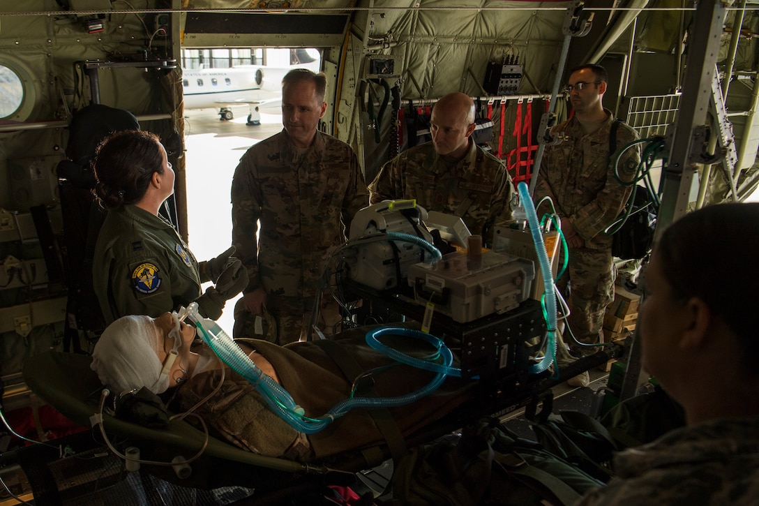 U.S. Air Force Capt. April Oliver, 86th Medical Squadron Critical Care Air Transport Team nurse, briefs Maj. Gen. John Wood, Third Air Force commander during a tour with the 86th Airlift Wing Oct. 5, 2018, at Ramstein Air Base, Germany. Falling under the Third Air Force, members of the 86th further explained the successful role they play in Ramstein's diverse mission. (U.S. Air Force photo by Senior Airman Devin M. Rumbaugh)