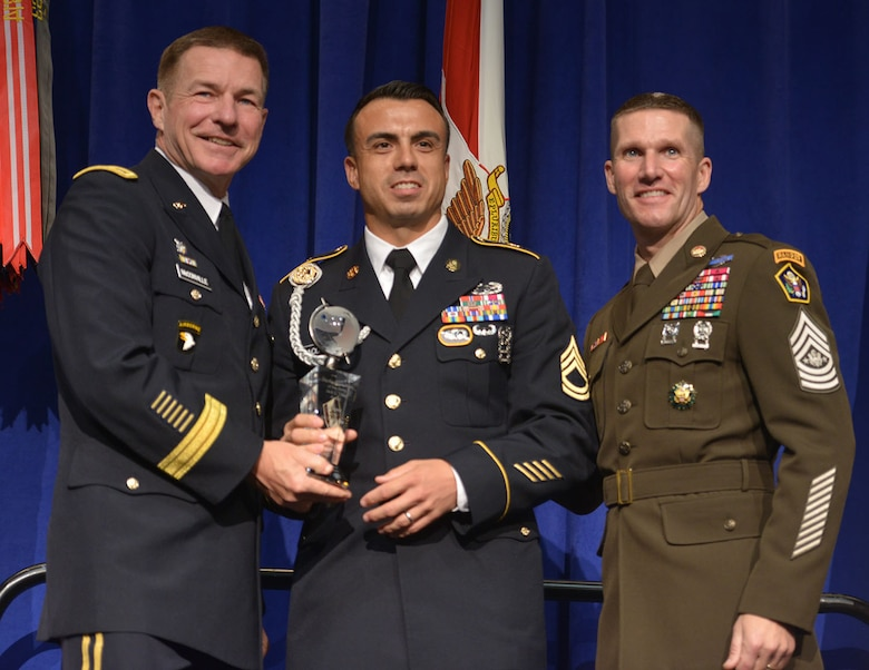 Sgt. 1st Class Sean Acosta accepts the NCO of the Year award Oct. 8, 2018. (Photo Credit: U.S. Army photo by Joe Lacdan)