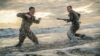 """Cpl. Matthew Teutsch, on the left, and Cpl. Brett Norman, both combat videographers with the 11th Marine Expeditionary Unit, participate in hand-to-hand and close quarters combat during martial arts training at Camp Pendleton, Calif., Oct. 2, 2018. The Marines worked on offensive and defensive techniques utilizing different weapons systems focusing on the motto of the Martial Arts Program: """"One Mind, Any Weapon."""""""