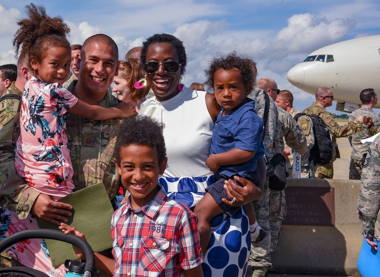 U.S. Air Force Master Sgt. Victor Chavez, 1st Maintenance Squadron, poses for a photo with his family after returning to  Joint Base Langley-Eustis, Virginia, Oct. 9, 2018. During a 6-month deployment, the U.S. Air Force Airmen and F-22 Raptors delivered air superiority during combat operations, supporting Operation Inherent Resolve and the fight against enemy forces in Iraq and Syria. (U.S. Air Force Photo by Staff Sgt. Carlin Leslie)