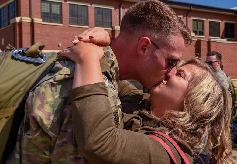 U.S. Air Force Staff Sgt. Justin Smith, 1st Maintenance Squadron load crew chief, kisses his wife Anna after returning to Joint Base Langley-Eustis, Virginia, Oct. 9, 2018. During a 6-month deployment, the U.S. Air Force Airmen and F-22 Raptors delivered air superiority during combat operations, supporting Operation Inherent Resolve and the fight against enemy forces in Iraq and Syria. (U.S. Air Force Photo by Staff Sgt. Carlin Leslie)