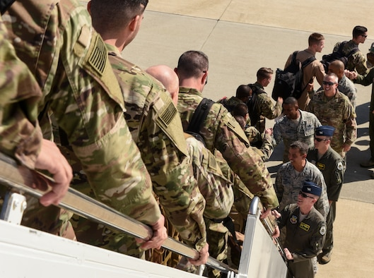 1st Fighter Wing senior leaders welcome U.S. Air Force Airmen from the 94th Fighter Squadron home at Joint Base Langley-Eustis, Virginia, Oct. 9, 2018.  During a 6-month deployment, the U.S. Air Force Airmen and F-22 Raptors delivered air superiority during combat operations, supporting Operation Inherent Resolve and the fight against enemy forces in Iraq and Syria. (U.S. Air Force Photo by Staff Sgt. Carlin Leslie)