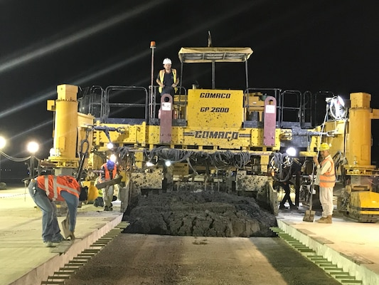 Contractors work at night to finish runway repairs at an undisclosed location in the Middle East.