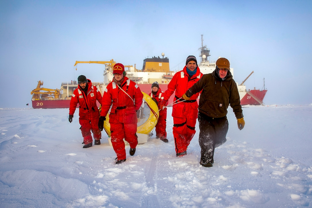 Five people carry a buoy across the flat, snowy ice.