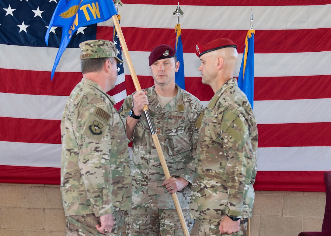 U.S. Air Force Maj. Gen. Timothy J. Leahy, Second Air Force, commander, 2nd Air Force Base, Mississippi gives command of the Special Warfare Training Wing (SWTW), Joint Base San Antonio-Medina Base, Texas to Col. James Hughes during the wing activation ceremony Oct. 10, 2018. The mission of the new wing is to select, train, equip, and mentor Airmen to conduct global combat operations in contested, denied, operationally limited, and permissive environments under any environmental conditions. (U.S. Air Force photo by Andrew C. Patterson)