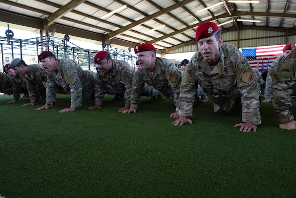 Members of the  Special Warfare Training Wing honor the fallen with memorial push-ups after the SWTW activation ceremony at Joint Base San Antonio-Medina Base, Texas Oct. 10, 2018. The mission of the new wing is to select, train, equip, and mentor Airmen to conduct global combat operations in contested, denied, operationally limited, and permissive environments under any environmental conditions.(U.S. Air Force photo by Andrew C. Patterson)