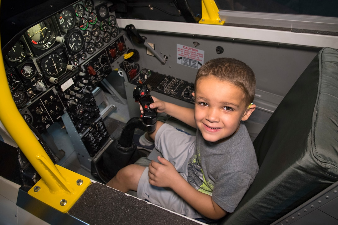 DAYTON, Ohio - A museum visitor enjoying the T-38 Sit-in Cockpit in the Cold War Gallery at the National Museum of the U.S. Air Force. (U.S. Air Force photo by Ken LaRock)