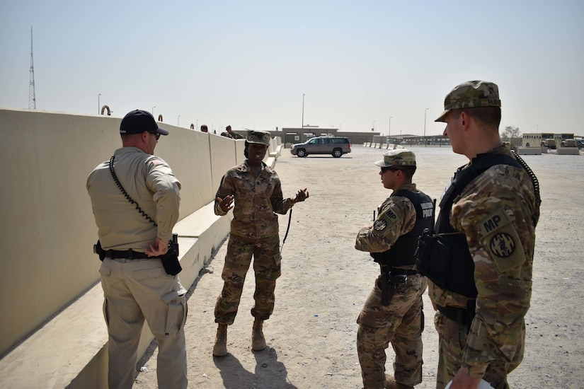 Members of the 535th Military Police Company and the Area Support Group-Kuwait the security team, discuss the semantics of evacuating simulated casualties to the hospital during the Mass Casualty Training Exercise at Camp Arifjan, Kuwait, September 26, 2018. Collaboration between different professions for situations like these are key in keeping the U.S. Army capable and ready.