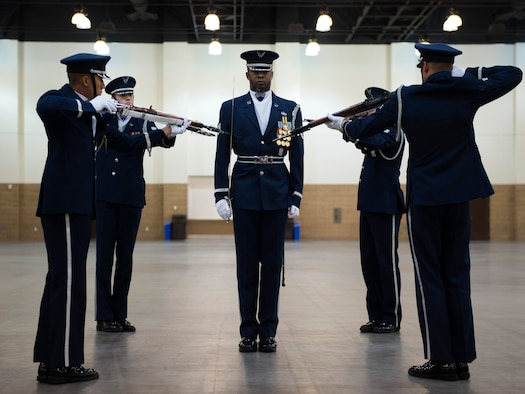 United States Air Force Honor Guard Drill Team performances feature a professionally choreographed sequence of show-stopping weapon maneuvers, precise tosses, complex weapon exchanges, and a walk through the gauntlet of spinning weapons. The Drill Team members perform over 100 times a year at various venues all over the world. (U.S. Air Force Photos/Senior Airman Philip Bryant)