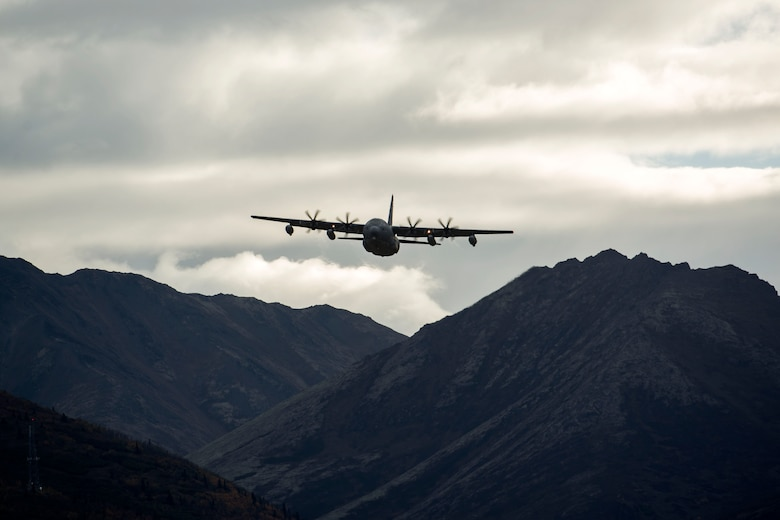 An Alaska Air National Guard C-130J Super Hercules conducts air drop qualification training at Joint Base Elmendorf-Richardson, Alaska, Oct. 3, 2018. When air drop training occurs, combat mobility technicians from the 773d Logistics Readiness Squadron are called upon to operate as malfunction officers at the drop zone. In addition to scouting the drop zone area during a training, technicians are also responsible to recover the loads and parachutes.