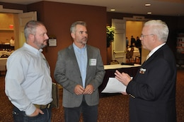 James Glynn, Walla Walla District's small business programs deputy, talks about U.S. Army Corps of Engineers small-business opportunities with Trent Milligan, AOR International Inc. president, and Jason Kanski, AOR International Inc. vice-president, during the 2018 Industry Day conference held Oct. 10, at the Marcus Whitman Hotel and Conference Center in Walla Walla, Washington. District personnel presented informational briefings, discussed upcoming contracting opportunities and processes, and a panel of District staff members involved with reviewing contract proposals answered questions posed by attendees