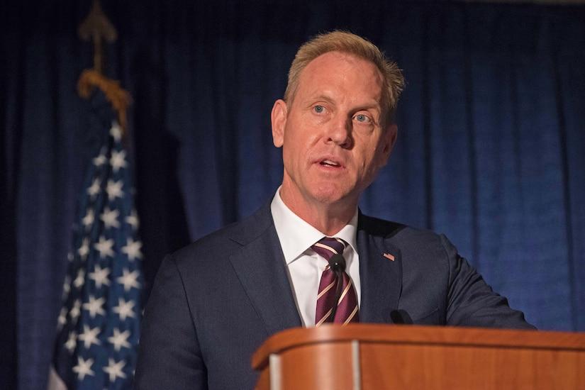 Deputy Defense Secretary Patrick M. Shanahan speaks at a podium.