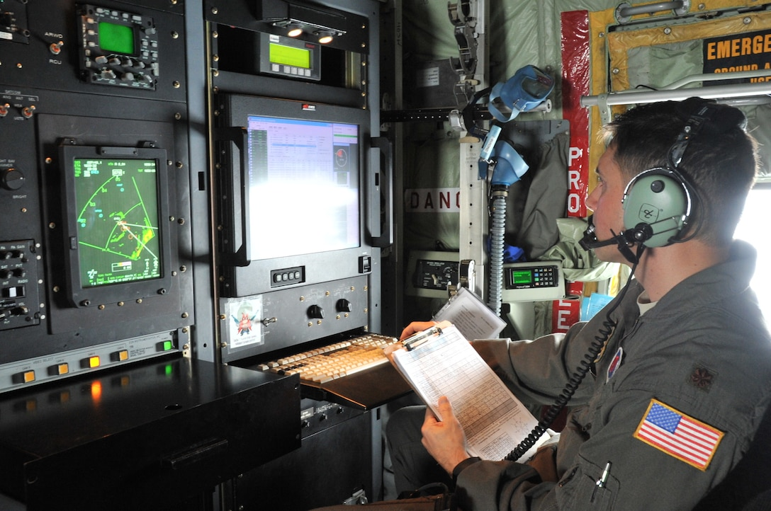 Maj. Jeremy DeHart, a 53rd Weather Reconnaissance Squadron aerial reconnaissance weather officer, reviews data prior to sending the data to the National Hurricane Center for Hurricane Michael, a Category 4 storm, which made landfall at Mexico Beach, Florida, today.  The Hurricane Hunters gather data from inside the storm to assist the National Hurricane Center in improving the cone of uncertainty that comes with tracking the path of a tropical cyclone. (U.S. Air Force photo by Master Sgt. Jessica Kendziorek)